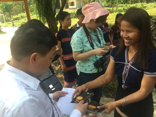 Visitors and vouchers at Ta Bhing community-based tourism village