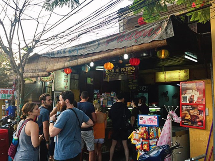 Tourists queue to buy bread in Hoi An.
