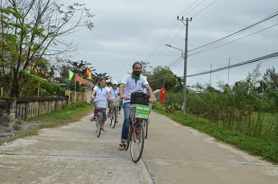 Foreign tourists riding bicycles in Hoi An city