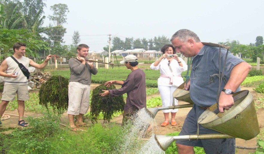 … and watering vegetables. Photo: TN&MT
