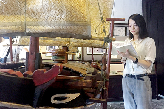 Saki and her work in a museum in Hoi An