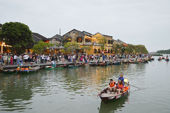 Tourists in boats in Hoai river, Hoi An city