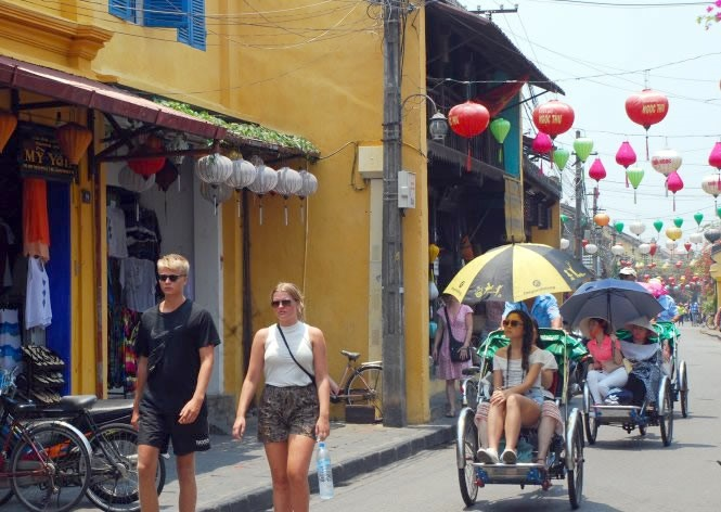 Visitors to Hoi An ancient town.