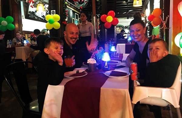 An foreign family welcomes the new year of 2019 in Hoi An city.