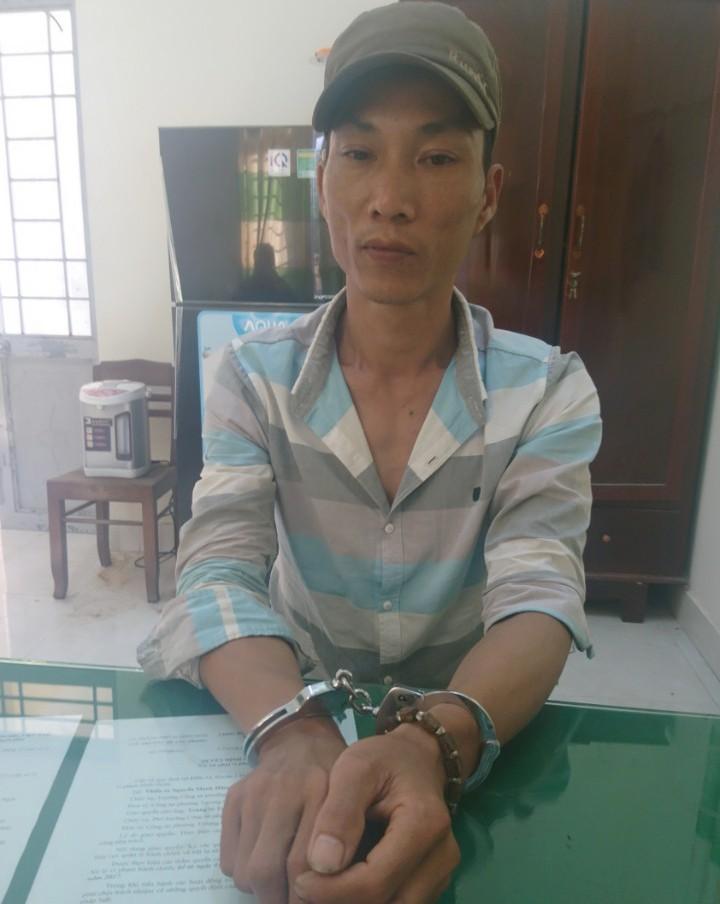 Đối tượng Lê Chí Trung tại cơ quan công an. Ảnh: P.NAM