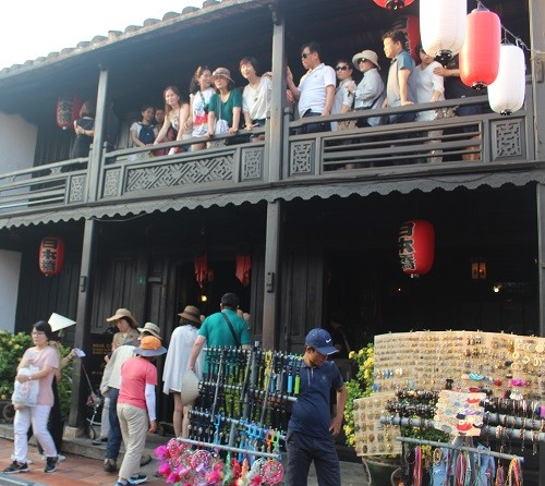 Visitors at an ancient house in Hoi An ancient town.