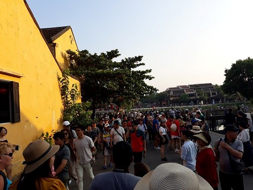 Hoi An ancient quarter is crowded with people.
