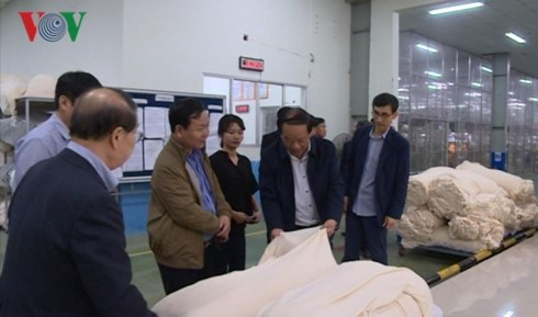 Quang Nam leaders visit a  foreign business in the province. Photo: VOV