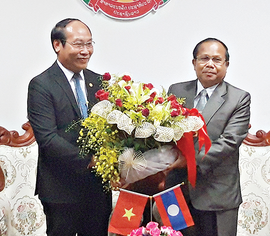 Chairman Ca (Left) and the Deputy Governor of Laos' Sekong province.