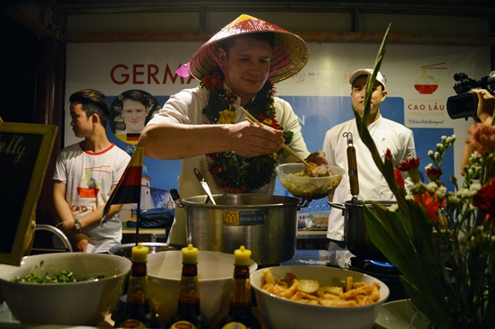 A chef performs cooking at the festival.