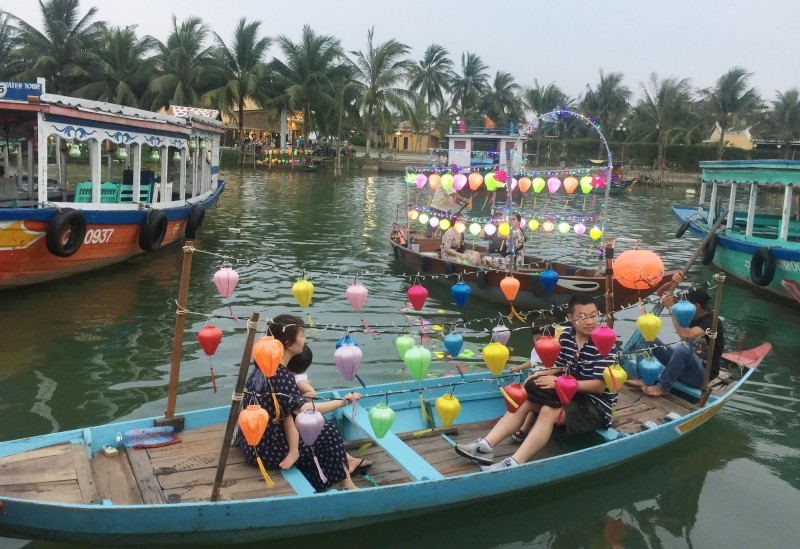 Visitors also like contemplating Hoi An night by boat.