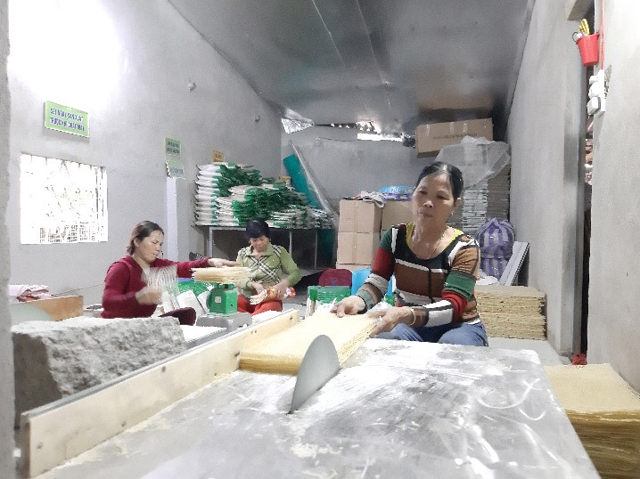 Workers at Anh's Caromi factory.