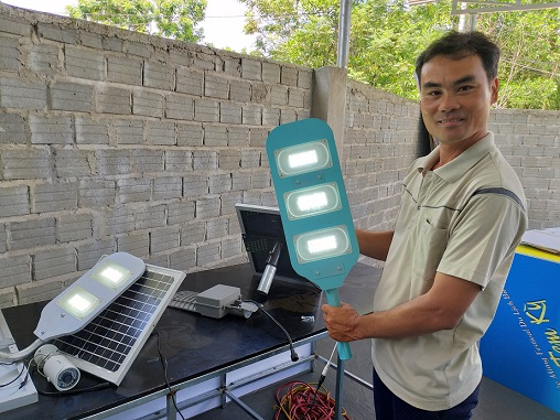 Pham Phu Hien and his products.